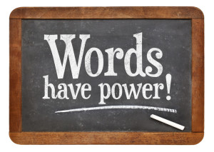 Words have power sign - white chalk text on a vintage slate blackboard